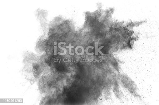 istock Black particles splatter on white background. Black powder dust explosion. 1160991293