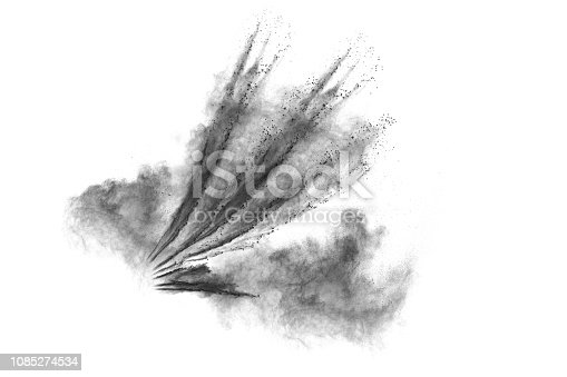 istock Black particles splattered on white background. Black powder dust splashing. 1085274534