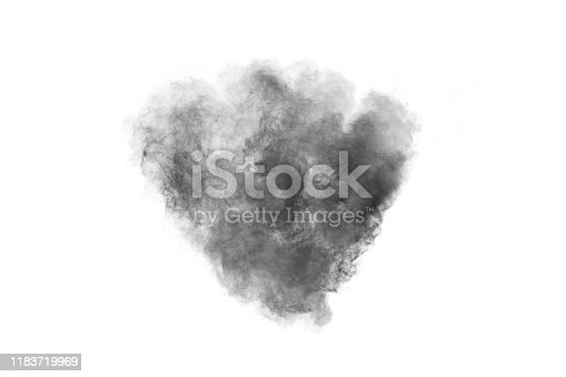 istock Black particles splattered on white background. Black powder dust splashing. 1183719969