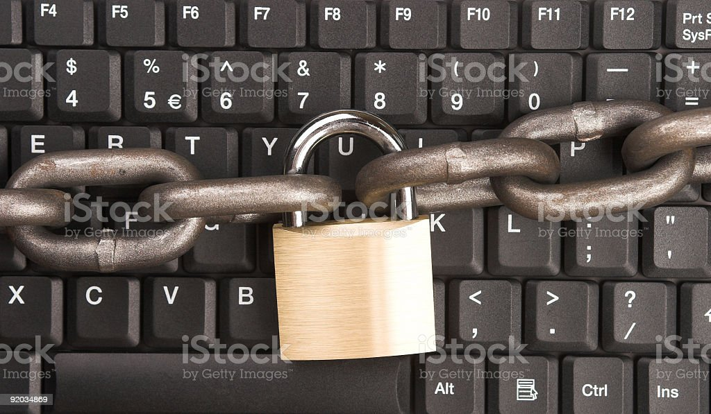 Black PC keyboard with chain link and lock stock photo