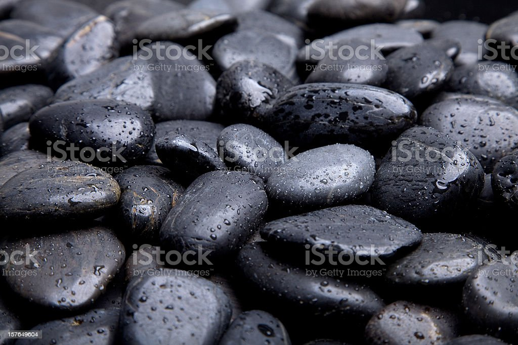black pebble stone stock photo