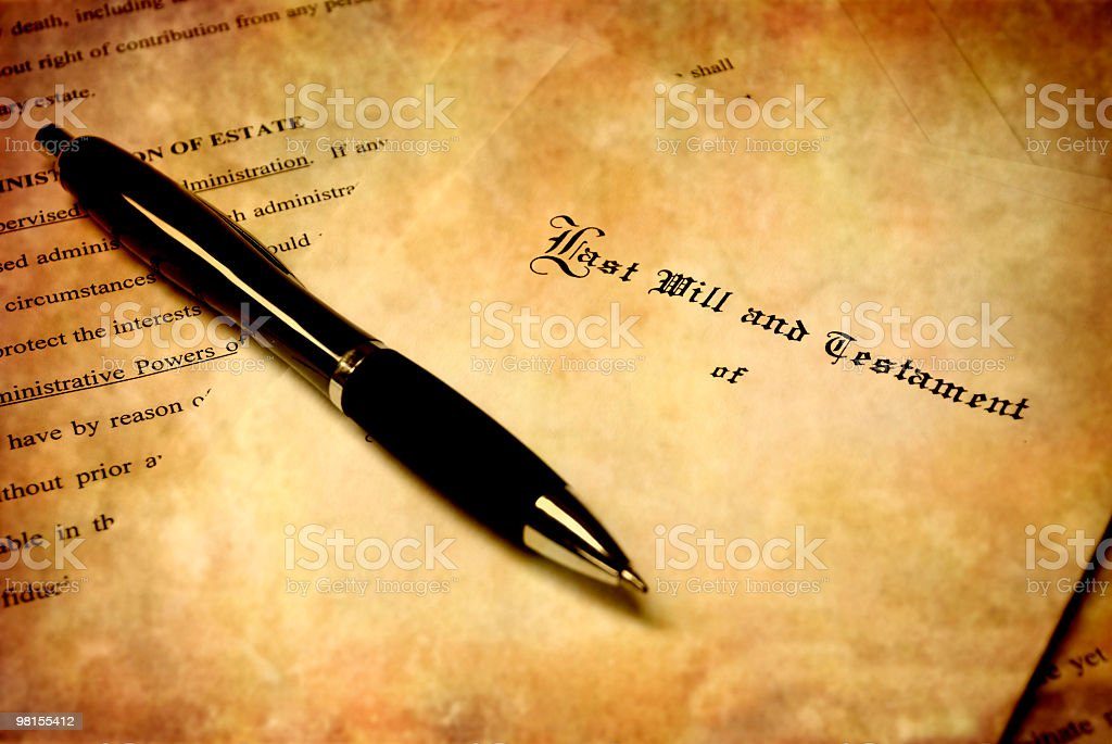 A black pen on top of an antique will royalty-free stock photo