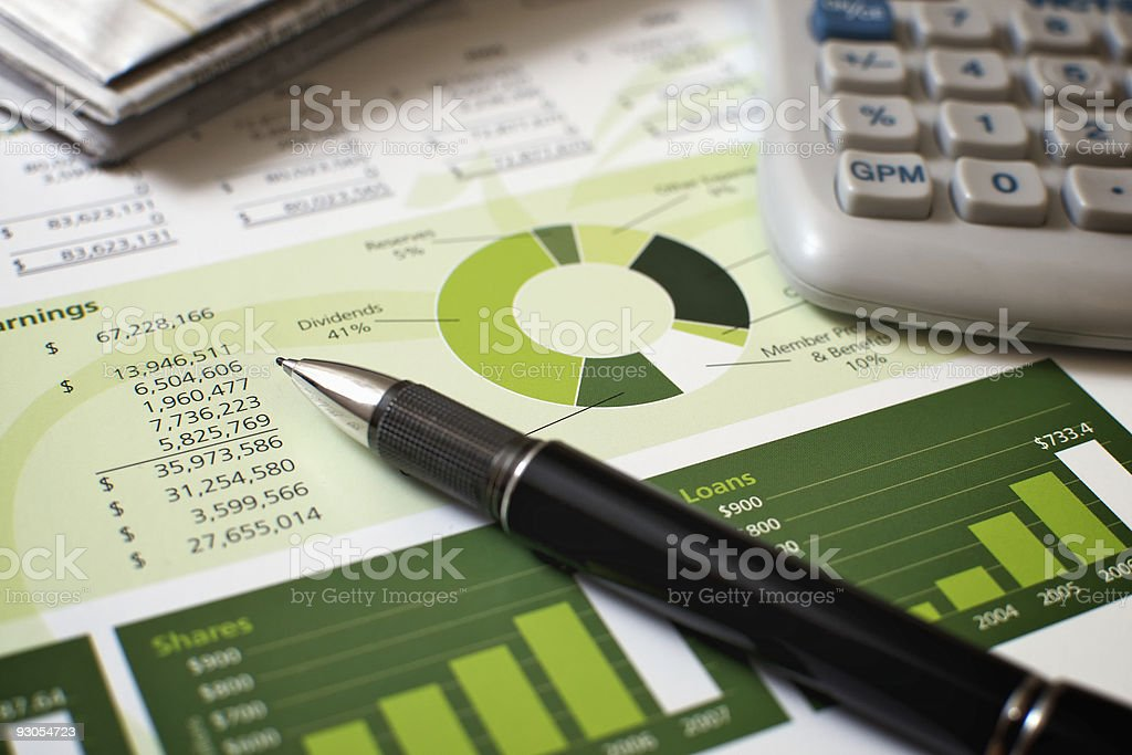 Black pen with financial figures and calculator stock photo