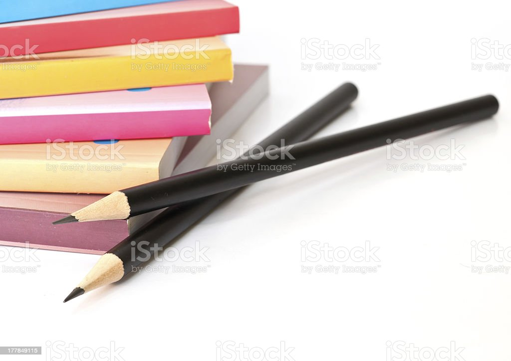 Black pencil and books. royalty-free stock photo