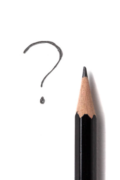 black pencil and question mark on a white sheet of paper stock photo