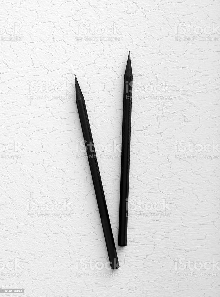 Black pencil on a white background royalty-free stock photo