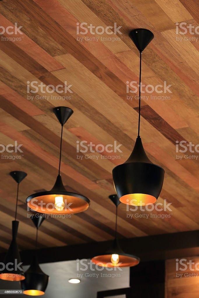 black pendant lamp on ceiling wood wall stock photo