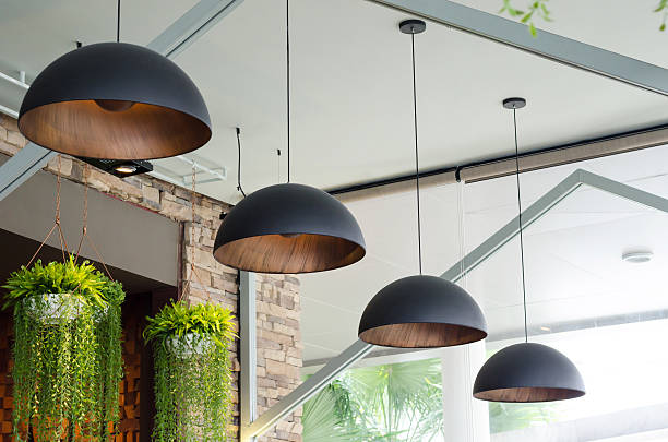 Black pendant lamps Black pendant lamps in medern interior amulet stock pictures, royalty-free photos & images