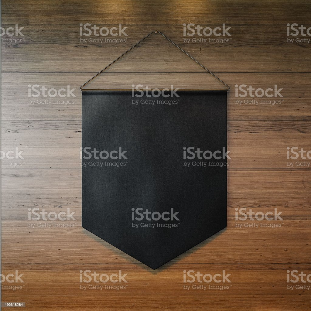 Black pennant hanging on the wall at wooden background. 3d stock photo