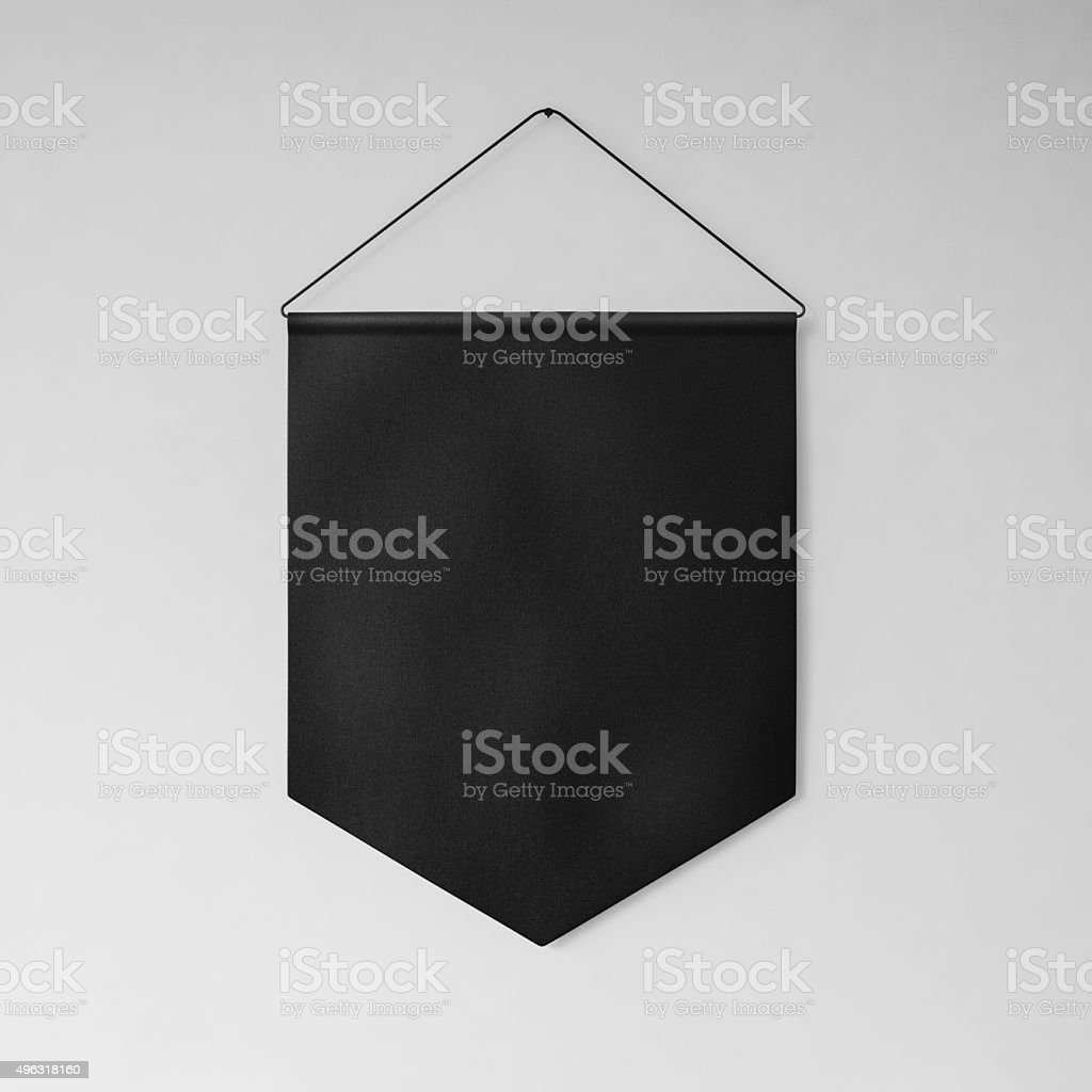 Black pennant hanging on the wall gray background. 3d render stock photo