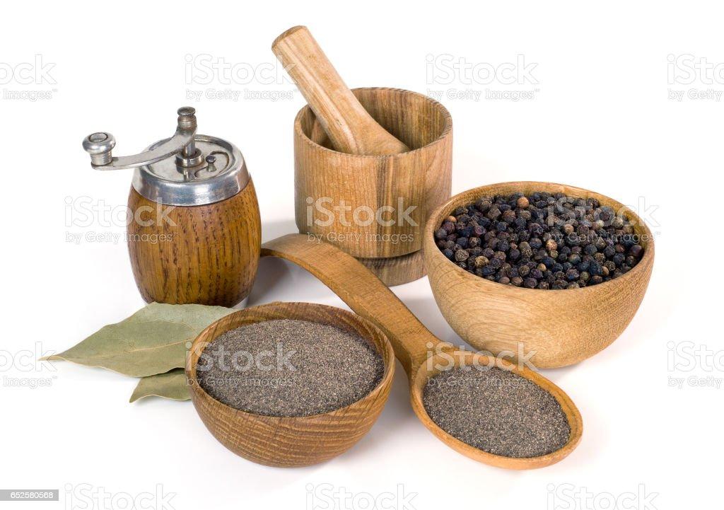 black pepper and wooden utensils on white background stock photo