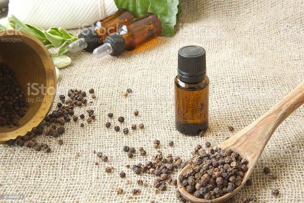 Black pepper essential oil stock photo