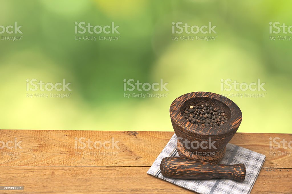 Black pepper in mortar stock photo