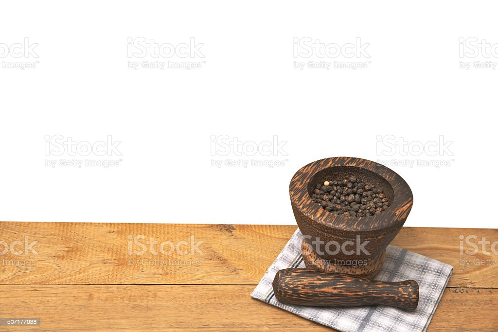 Black pepper in wooden mortar stock photo