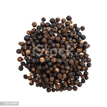 Heap of black pepper shot from above isolated on white background