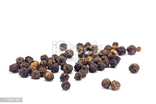 black pepper grains isolated on white background
