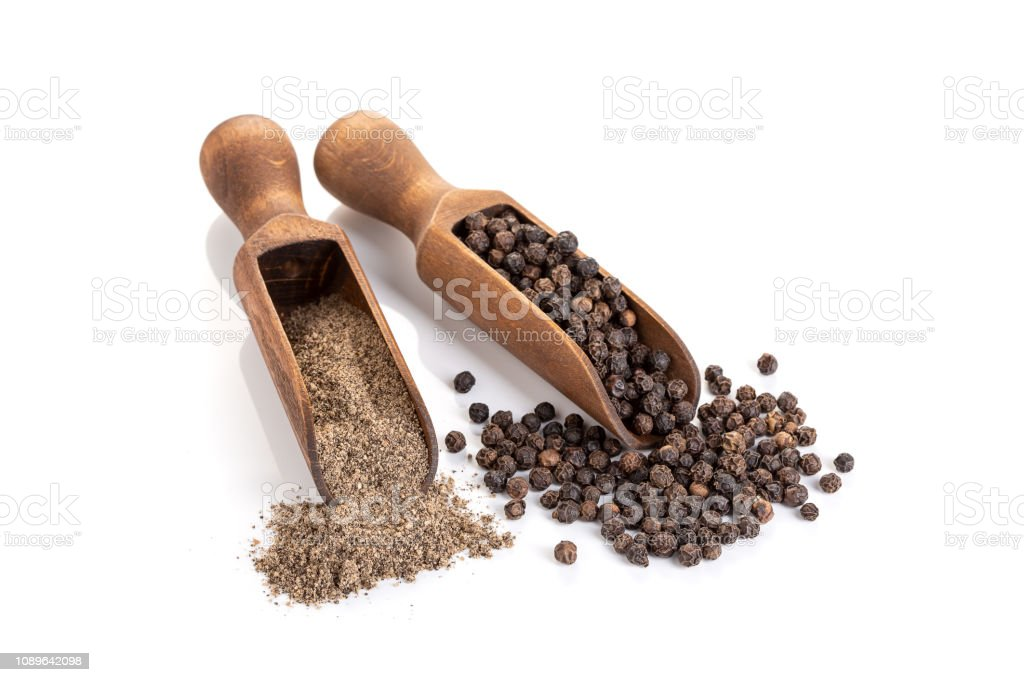 Black pepper seeds and Black pepper ground isolated on white background stock photo