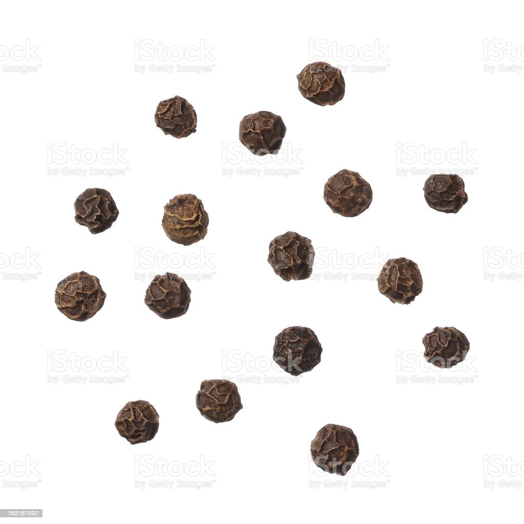 Black pepper seeds on a white background stock photo