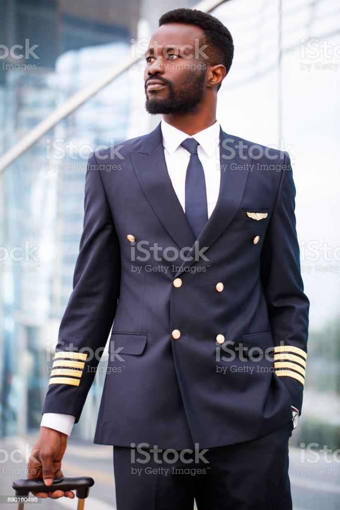 Black person pilot walking at the airport stock photo