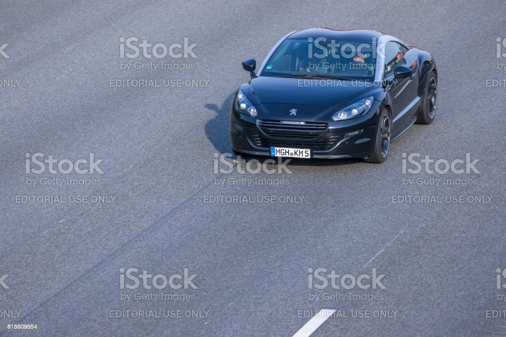 Black Peugeot RCZ sportscar driving on a german highway stock photo