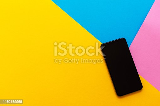istock Black phone on colorful background 1160185568