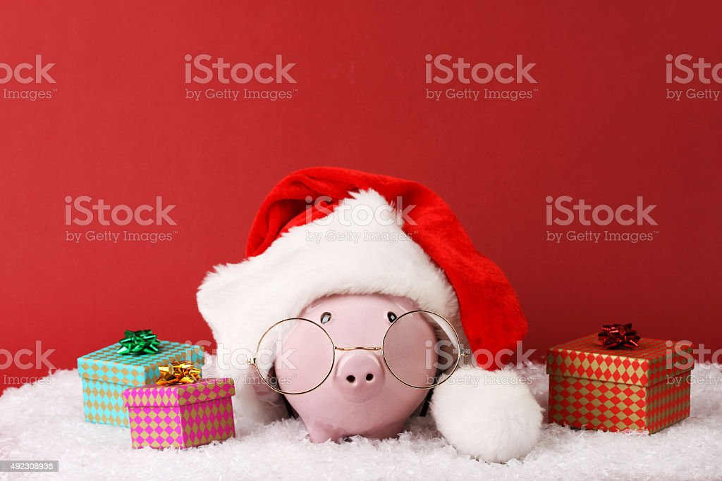 Black piggy box with text Xmas standing on fur stock photo