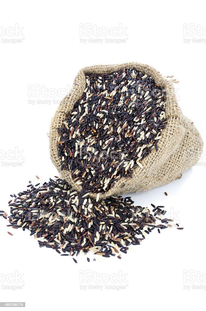Black pile Rice in Gunny bag royalty-free stock photo