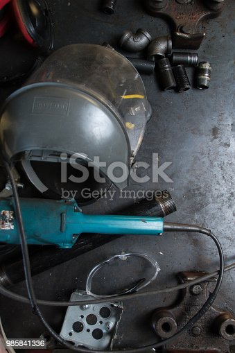 istock Black Pipe on a Steel Background 985841336