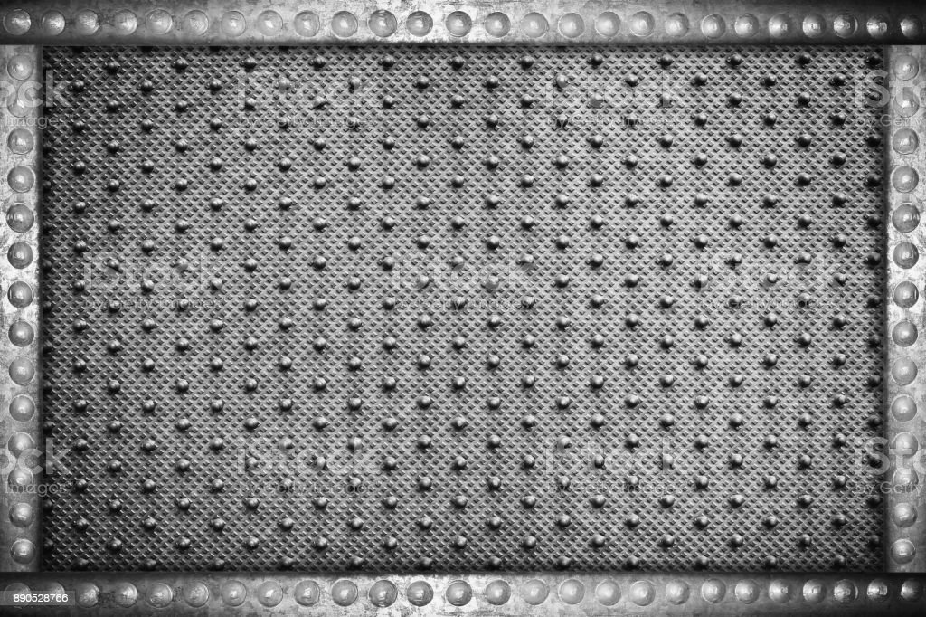 black plastic background with metal rivets frame stock photo