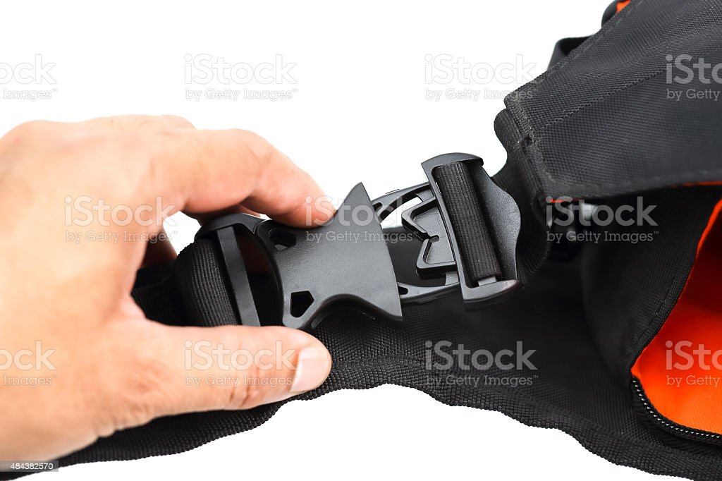 Black plastic buckle on backpack stock photo
