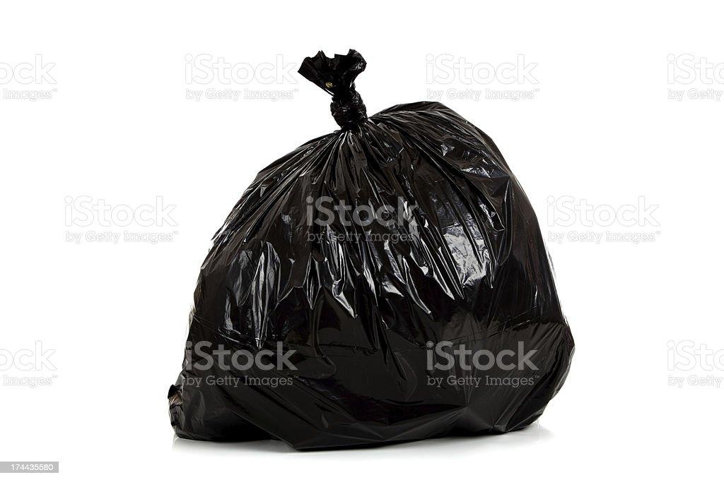 Black plastic garbage bag on white stock photo