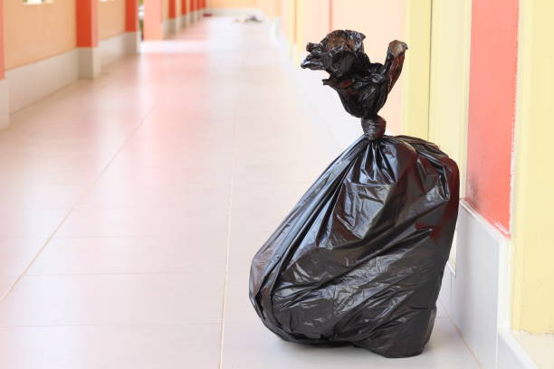 Black plastic garbage bags stock photo
