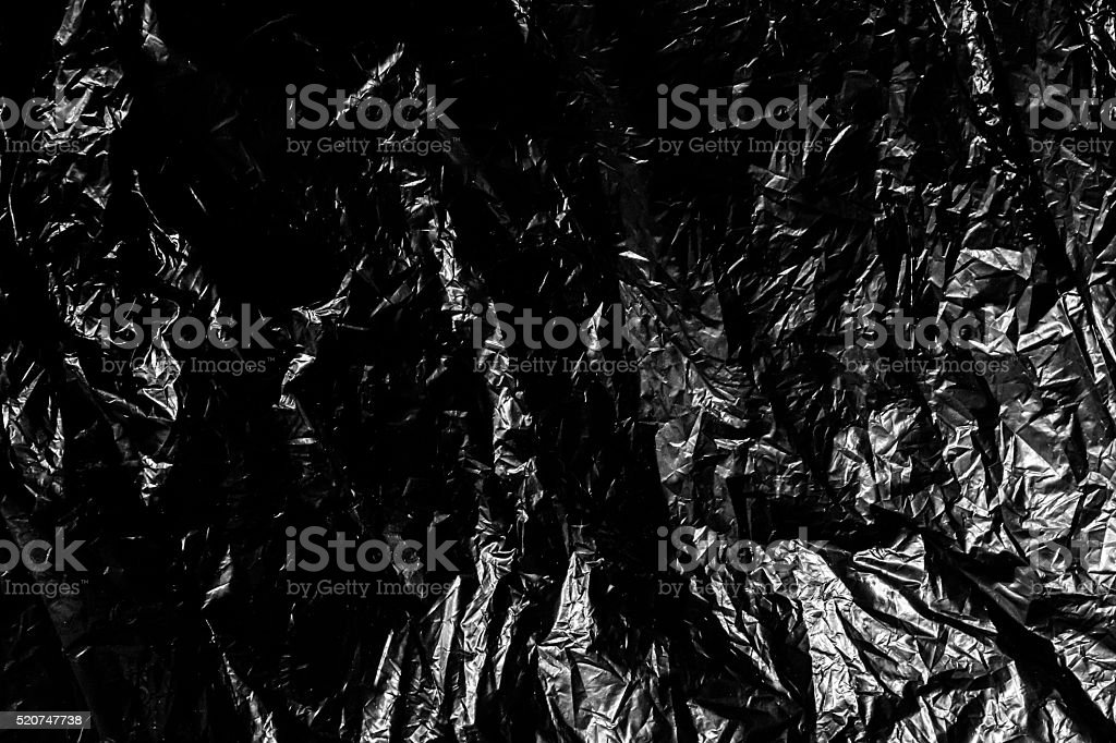 Black plastic garbage material as a background stock photo