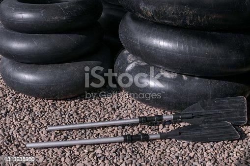 Black plastic kayak paddle and Black swim ring
