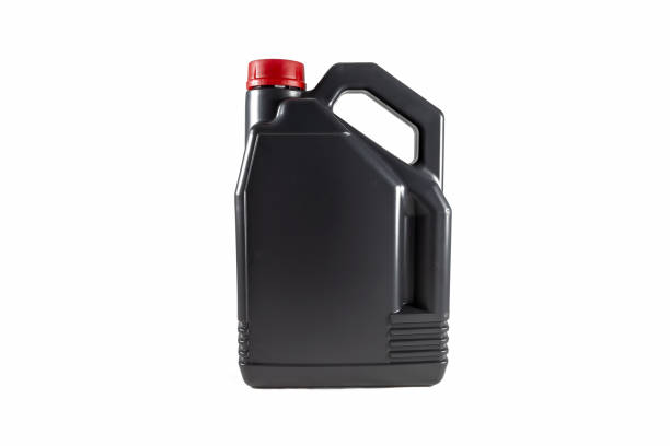 Black plastic motor oil canister 5 litres. Isolated on white background Black plastic motor oil canister 5 litres. Isolated on white background. gallon stock pictures, royalty-free photos & images