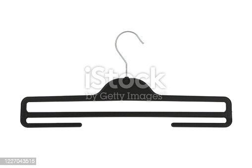 Black plastic pants / skirt hanger isolated on a white background