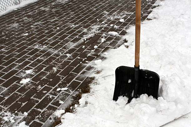 Black plastic snow shovel and pavement picture id511870702?b=1&k=6&m=511870702&s=612x612&w=0&h=brzdtaj6vzz3bnkwcdix6ff itce6r a ysu4xacgfm=