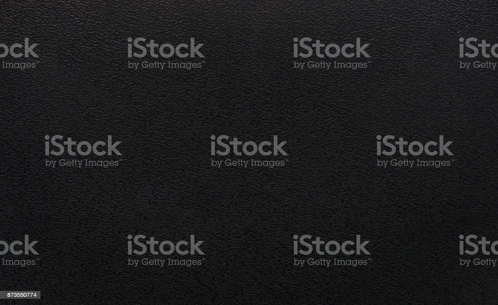 Black plastic texture background. Dark rough material in pvc object. stock photo