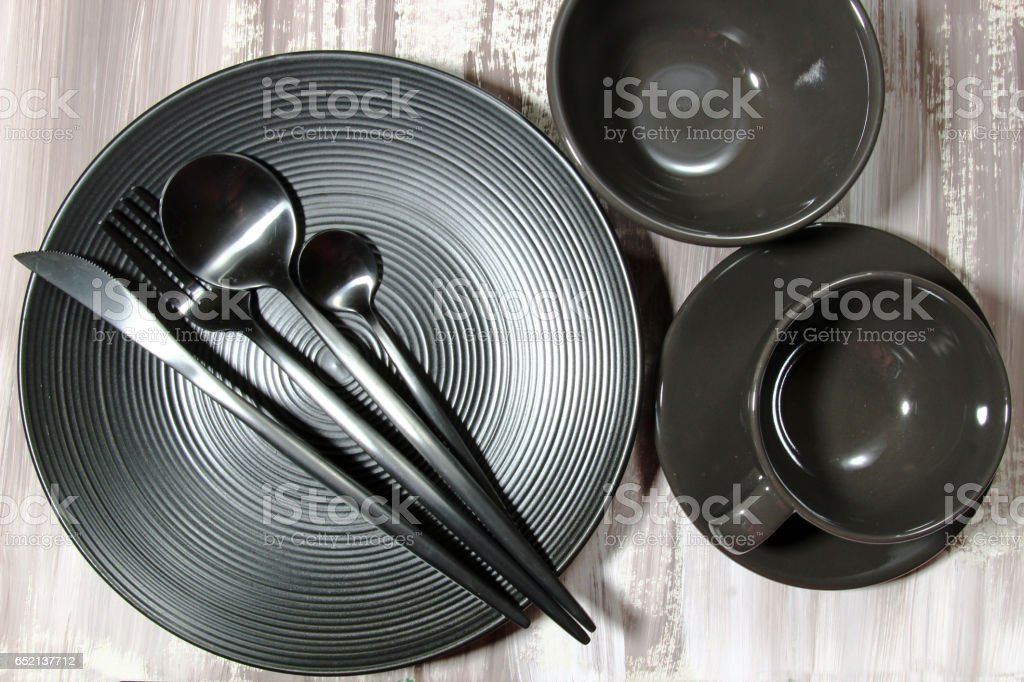 A black plate with cutlery stock photo