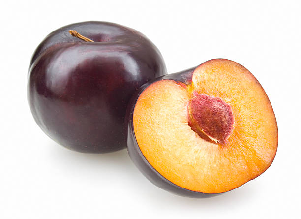 black plums stock photo