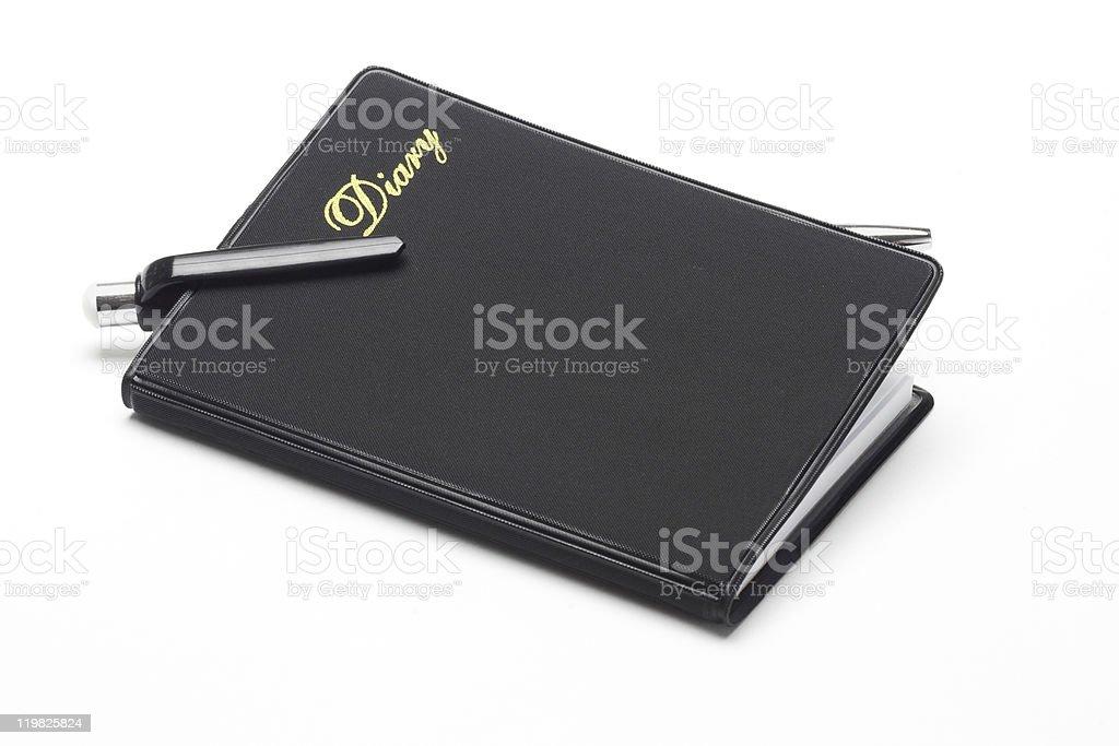 Black pocket diary and ballpoint pen stock photo