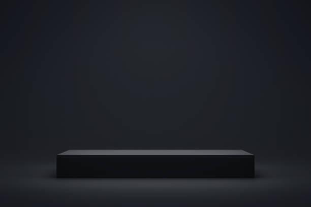 Black podium or pedestal display on dark background with long platform. Blank product shelf standing backdrop. 3D rendering. stock photo