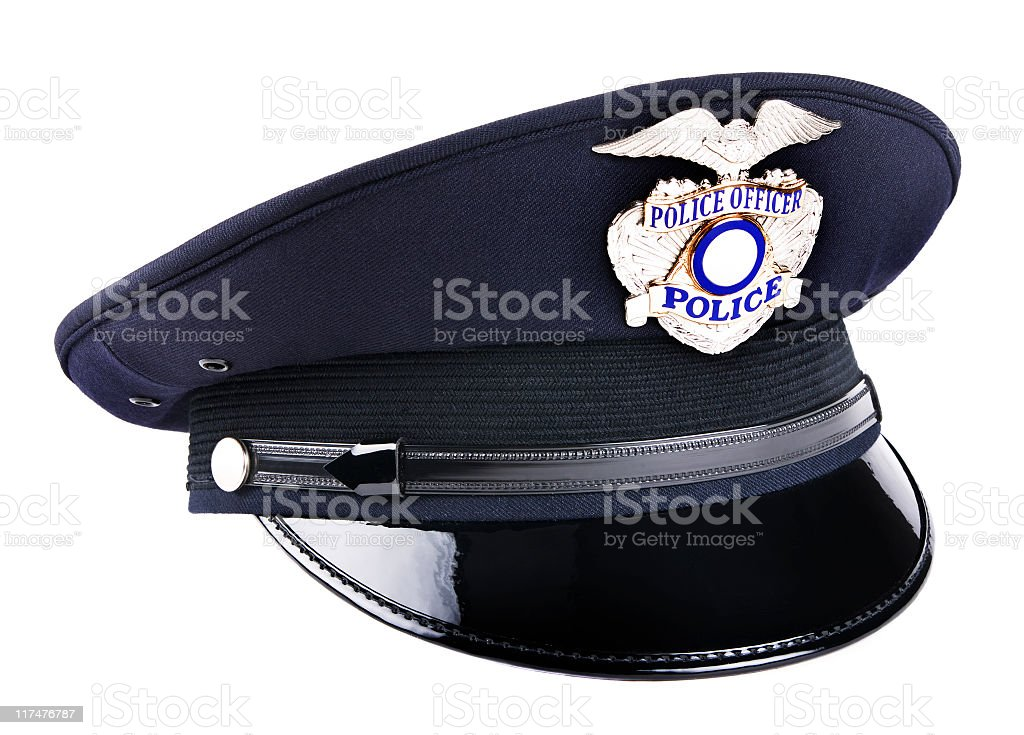 A black police cap with metal badge  stock photo