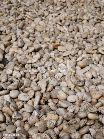 istock Black Polished River Stones 1129863380