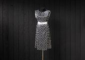black polka dot dress on a mannequin