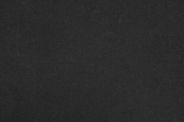 black polyester synthetic cloth textured background - nylon texture stock pictures, royalty-free photos & images