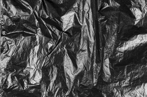 black polyethylene rumpled. abstract background. space for text