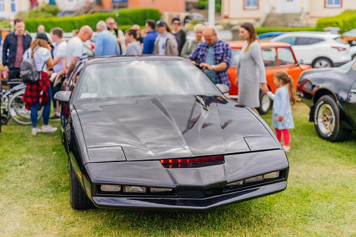 Bray, Ireland, June 2018 Bray Vintage Car Club show, open air retro cars display. Black Pontiac Firebird stylized as KITT from Knight Rider TV series