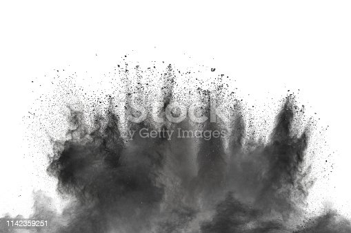 istock Black powder explosion against white background. Charcoal dust particles exhale in the air. 1142359251