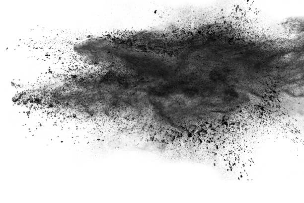 black powder explosion against white background. - coal stock pictures, royalty-free photos & images